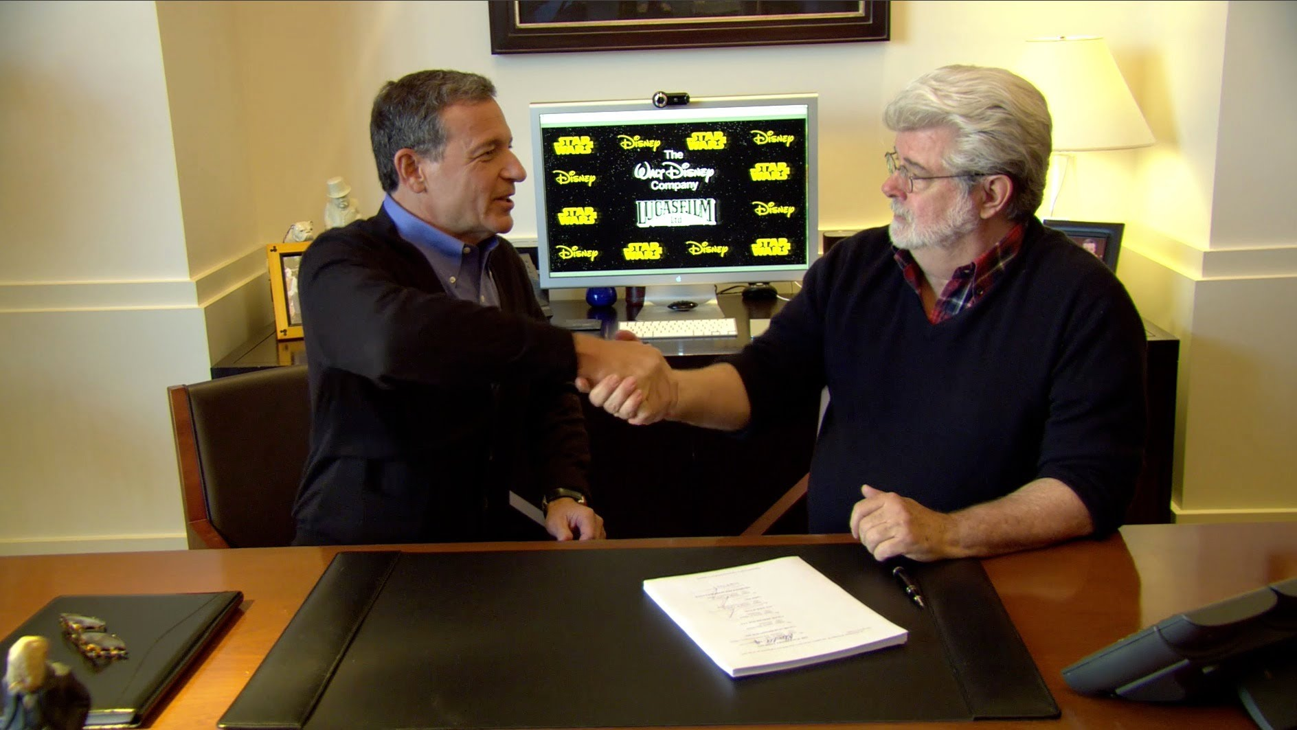 George Lucas and Bob Iger sign Lucasfilm and Star Wars over to The Walt Disney Company in 2013.
