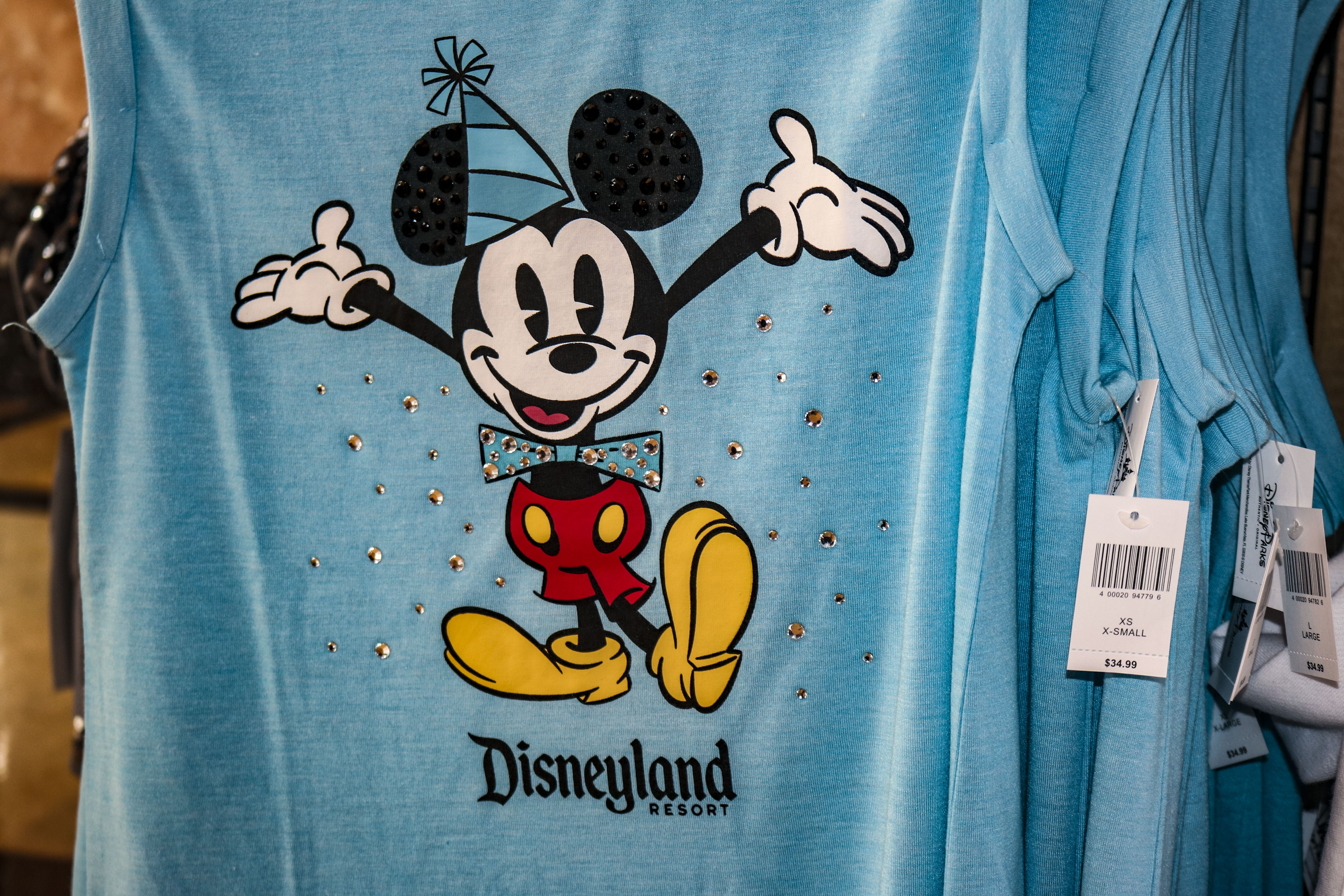 This Collection Has A Wide Assortment Of Colorful T Shirts Hoodies And Outerwear All Featuring The Same Mickey Mouse 90 Design Mickeys Dapper Birthday