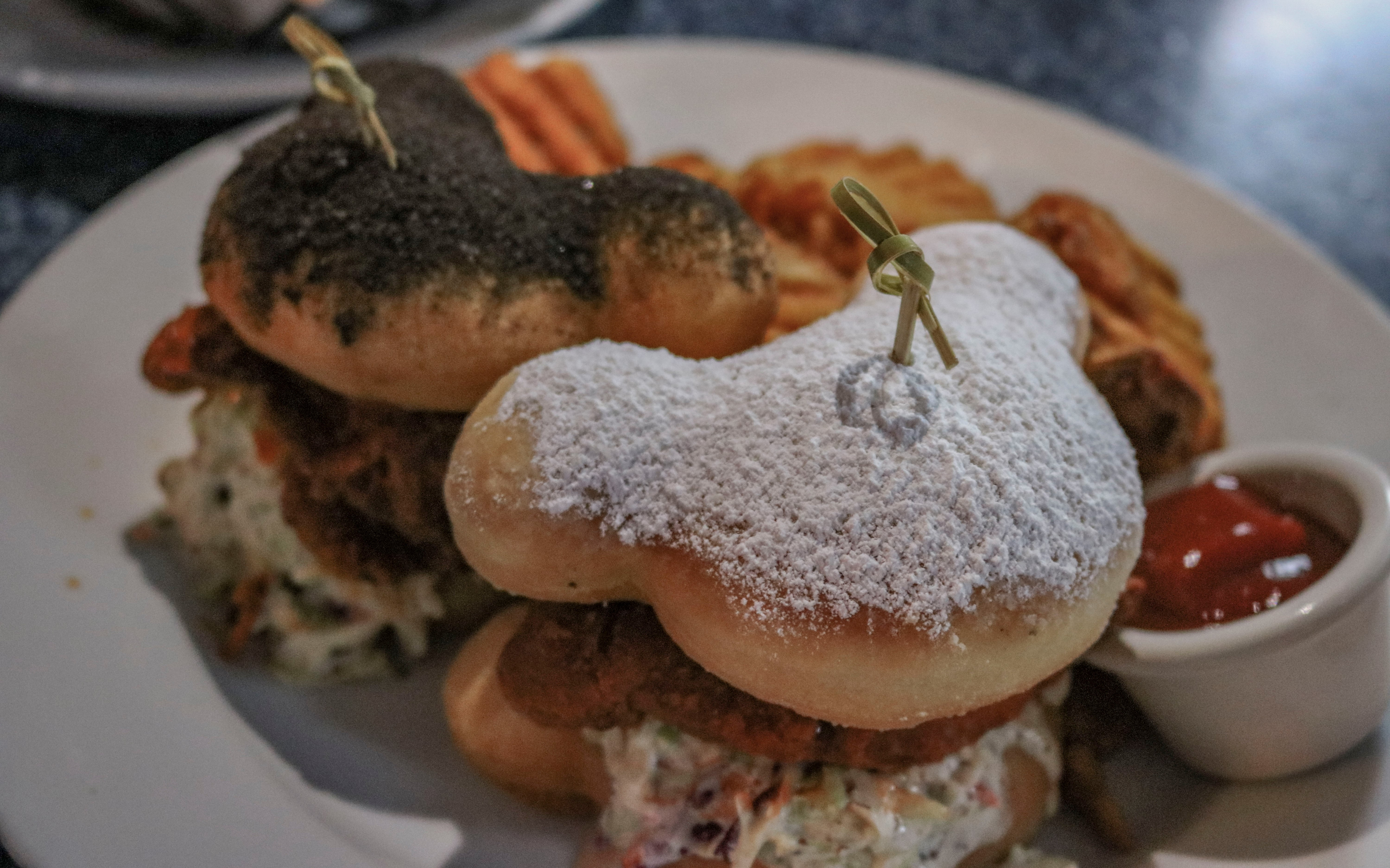 Later on, I discovered the incredibly tasty Mickey Beignet sandwich plate from Cafe Orleans. It takes the best of both worlds and brings the sweet and savory of buffalo chicken and baked beignets together in a heavenly meal that is perfect to share!